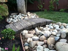 Another fine example of what can be done with concrete. That is concrete shaped, stamped and colored to look like railroad ties. A great idea for those of you looking to fill dead space in a yard, without having to upkeep a flower bed. I'll show you guys how to build it in Yard Crashers 802.