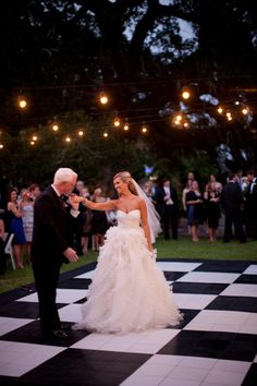 Outdoor dance floor with heaters. I don't mind the black & white checker print. -O  like the setting! :)