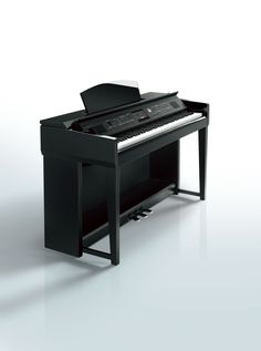 Yamaha Clavinova CVP-605 digital piano, in polished ebony finish, has a huge range of (synthesized) 'voices'.