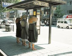 Just an ordinary day at the bus stop. (i know its monks but that's how it feels when you're out in garb...)