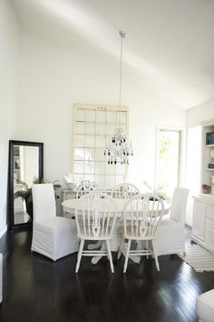 White oval kitchen table - Aaron repainted a table for me just like this one.