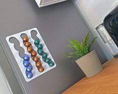 CapsuleSlide Magnetic Nespresso coffee pod holder by Hologramer