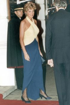 1992 - Diana chose a colour blocked, full-length dress with cross-over halter neck detailing, for a performance of Othello in Covent Garden.