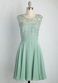 Raising a glass, everyone in the room honors your mint green dress. Your best…