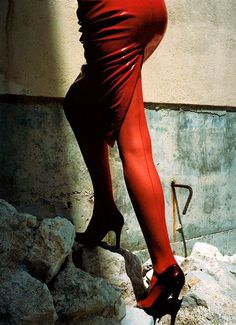 Helmut Newton  red dress, tights and shoes