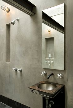 Minimalist concrete industrial bathroom with bunker cage style wall light. (Available in Australia via www.FatShackVintage.com.au)