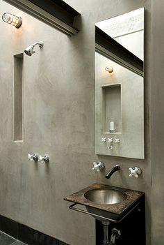 Minimalist concrete industrial bathroom with bunker cage style wall light. (Available in Australia via www.FatShackVintage.com.au)