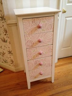 Lingerie chest painted in Annie Sloan Pure White with Royal Design Studio's Rockin Roses stencil on the drawers. Stenciled in 2 different mixes of Antionette and Old White and a mix of Versailles and Old White. New pink knobs added as well. So cute and girly!