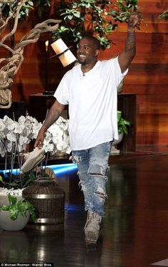 Good spirits: The 38-year-old rapper had a big smile on his face as he sported an oversized white shirt, ripped jeans and a pair of his Adidas Yeezy Boost 950 duck boots