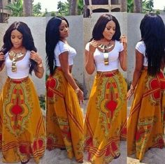 The African Shop -- Oh yes ma'am! love this African print maxi skirt paired with a simple white crop top and statement neckless!