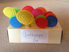Candy store props.  Lollipops made from fun foam and Popsicle sticks.