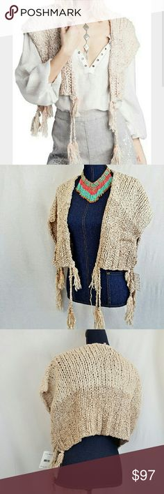 "FREE PEOPLE New M Boho Beige Shrug Sweater Just Listed! I adore the boho tassels on this comfy sweater!  This creamy beige sweater is by Free People.  Such a versatile piece that can work with almost anything in your closet!  I just love it. Approximate flat measurements: length of the body of the shrug (without tassels) is 16"" , 29"" length . Size Medium . Brand new with tags! An eye-catching winter top that will become a staple in your closet! Free People Sweaters Shrugs & Ponchos"