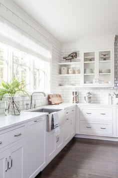 Modern Farmhouse Kitchen with counter to ceiling subway tile and shaker style cabinets #ModernFarmhouseKitchen #modernfarmhouse #kitchen #countertoceilingbacksplash #subwaytile #sakerstylecabinet Chango & Co