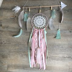 Arrow dreamcatcher. Tribal mint pink and white arrow dreamcatcher. Unique and custom made. #unique #arrow #dreamcatcher