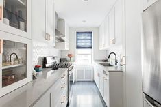 Ask any homeowner, and they'll tell you their kitchen's too small. There's never enough space, even if you've installed toe-kick drawers and an over-the-door organizer to sneak a few extra shelves … Open Galley Kitchen, Kitchen Built Ins, White Kitchen Appliances, Kitchen Design Open, Small Kitchen Storage, Kitchen Reno, Kitchen Remodel, Kitchen Organization, Small Space Living