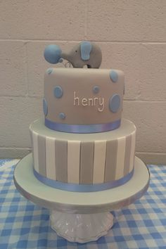 Two tier christening cake, boys blue and grey wit elephant topper