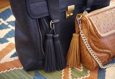 DIY Tassel Bag Charm        You'll need: 8-9″ piece of leather fringe, tacky glue, 2-5 inches of ball chain,1 ball chain connector, rubber band, scissors
