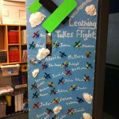 Airplane themed classroom door.