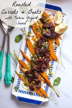 Roasted Carrots and Beets with Tahini Yogurt Sauce- an easy and vegan side dish!