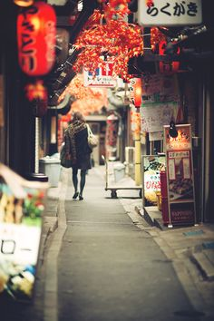 """Let everything happen to you Beauty and terror Just keep going No feeling is final."" - Rainer Maria Rilke                                                                          Tags: japan street girl japanese lanterns autumn fall life quote"
