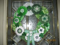 St Patty's Day Wreath - Covered a foam wreath with ribbon, made paper rosettes using Stampin' Up's Designer Rosette Bigz die, Flowers made using S.U's Fun Flowers die, all hot glued onto ribbon covered wreath,  added a striped bow and some bling!