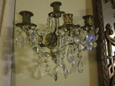 Pair Of Antique French Victorian Bronze and Crystal Sconces