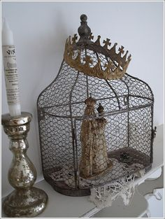 love the old cage with the rusty old crown on top!