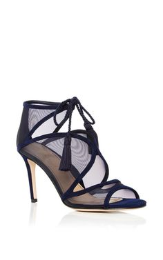 Following the successful premier collection of luxurious & comfortable footwear by designer **Marion Parke** this Pre-Fall collection retains its carefully crafted fashionable edge. The designer merges intelligent design at a luxury level with her revolutionary footwear, focusing on repositioning and supporting the foot with her patent-pending four-part insole. This sandal by **Marion Parke** is rendered in navy suede and features navy mesh detailing and tassel embellishments.