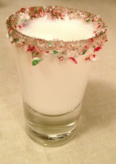 The Candy Cane Ingredients: Godiva White Chocolate Liqueur Peppermint Schnapps Crushed Candy Canes Directions: 1} Wet the rim of a shot glass and dip into the crushed candy canes. 2} Mix equal parts Godiva white chocolate liqueur and Peppermint schnapps together, Shake and Pour into the rimmed shot glass and viola! Festive and delicious shots for your next Christmas Party!