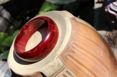 Bakelite bangle https://www.etsy.com/listing/250656412/bakelite-marbleized-red-maroon-bangle?ref=shop_home_active_1