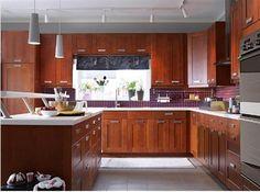 ikea medium brown cupboards. white floor.