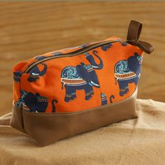 Elephant Print Leather Travel / Cosmetic Pouch. https://www.qtrove.com/products/elephant-print-with-tan-faux-leather-travel-cosmetic-pouch Hand-crafted leather & hand printed canvas. A very convenient size for storage of toiletries. https://www.qtrove.com/products/elephant-print-with-tan-faux-leather-travel-cosmetic-pouch