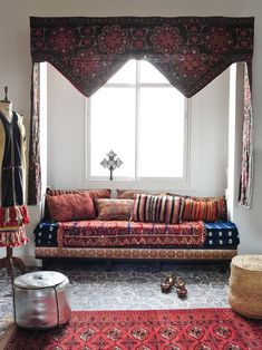 """Moroccan bohemian style to full effect. To get this look, pile a variety of textiles on your bed or couch and top with a cacophony of cushions. Lay a colorful rug over a patterned floor. Remember, more is more. Tip: Poufs are not only a great decorative element; they provide seating and extra surface space"""