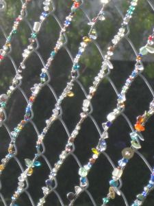 bead bombing!  beaded chain link fence. | streetcolor