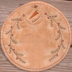 Youre buying this sweet candle mat designed and stitched by me on muslin and batting then stained and baked. It measures approx. 8 across and is