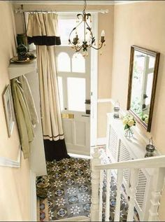 Dress up your entry (while blocking drafts) with a curtain on the inside of the front door, Photo credit: This Old House