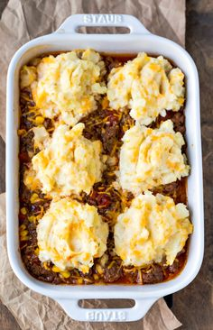 Barbecue shepherd's pie in a white baking dish on a piece of brown parchment paper