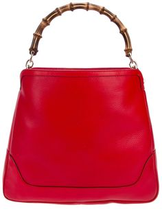 Gucci bamboo handled bag in red.