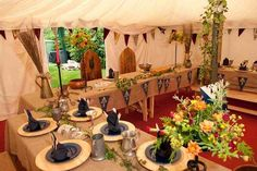 lovely medieval feast set up in a tent.   I don't think I am crazy enough to try something this elaborate at Pennsic.