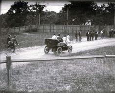 First runners leaving the stadium during the 1904 Olympic Marathon Race. (Mellor and Spring in front of referees' automobile).