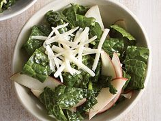 Kale Salad with Apple and Cheddar | Fresh takes with America's favorite green! Curly and Lacinato leaves are hearty, so plan to massage those leaves a bit to make them easier to eat. If you want straight-from-the-bag greens that are ready for the plate, look for baby kale leaves instead. This collection of our favorite kale salads also features tips for making sure the salad you plate is the best it can be. If you don't have kale but love the flavors of the salad, substitute for spinach,