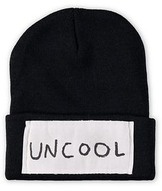 "Get next level style with this fold beanie that features a large patch with ""uncool"" lettering at the cuff, while the tight fit and thick knit construction offers absolute comfort."