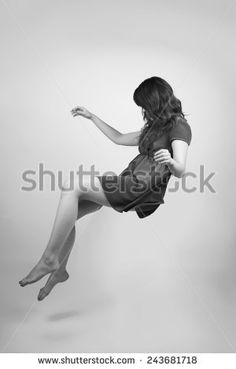 Woman in a teal dress floating in black and white - buy this stock photo on Shutterstock & find other images.