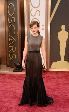 Credit: Jason Merritt/Getty Images      Credit: Jason Merritt/Getty Images Emma Watson at the Oscars 2014 Hollywood & Highland Center in Hollywood, California on March 2, 2014 Emma looks glamorous and edgy in a Vera Wang top and skirt and Jimmy Choo shoes. She topped off the look with Solange earrings, an Anita Ko ear cuff, a Chanel bow ring, Repossi rings, and an Anya Hindmarch clutch. Emma...