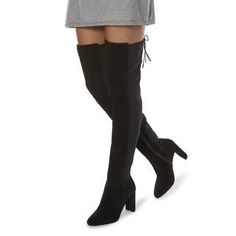 This sensual over the knee boot makes the ultimate style statement. It features a high chunky heel, lace up back and inside zip fastening. The stitch panel detail and rounded toe complete this show-stopping style.