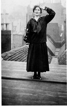 A British woman who has recently joined the United States Navy salutes. Ca. 1918.