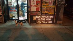 Illumination Against Gentrification signs outside a bodega (all photos courtesy Illumination Against Gentrification)