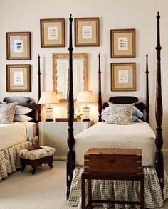 Love the four poster beds and the skirted table with two lamps in between!