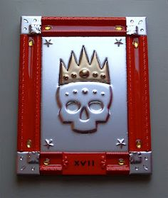 "This is a wall-hanging relief piece titled ""number 17""    The content is a skull with a crown looking as if they are made of pressed brass/tin. It is a faux-finish approach to the material as it is in fact, spray paint on wood. The death's head has a rich history in art, and I love it as the archetypal symbol. in this case it's a loaded symbol to hang paint on.    Wood, acrylic, epoxy, glass, spray paint  15""H. 12""W."