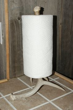This unique paper towel holder would look great on any rustic counter top. The base is a small 4-point that is 11.5 x 8 and is 16.5 tall.